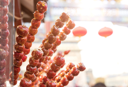 Sugarcoated haws on a stick 免版税图像