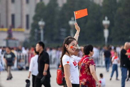 BEIJING-October 3: Celebrate the national day on October 3, 2019 in Beijing, China. People celebrating China National Day in Tiananmen Square. 写真素材 - 140144085