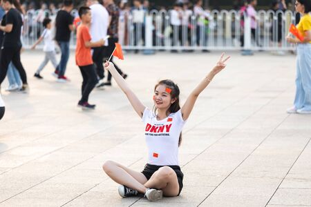 BEIJING-October 3: Celebrate the national day on October 3, 2019 in Beijing, China. People celebrating China National Day in Tiananmen Square. Redakční