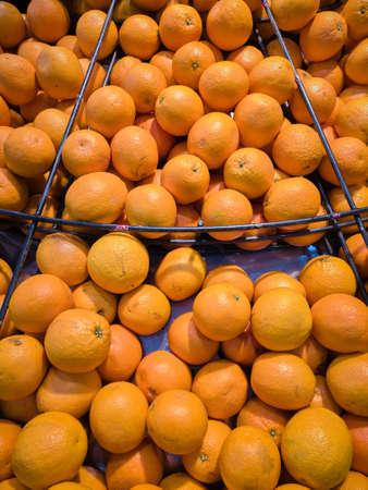 Mandarins on slate in market, Fresh harvested