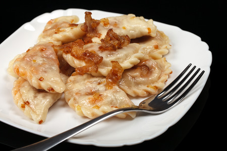 Traditional Ukrainian dumplings with bacon and cabbage.