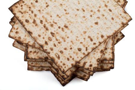 Traditional Jewish matzah on a white background. Close-up Stock Photo