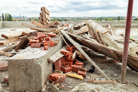 Construction waste on the roof of the house under construction. Outdoors Stock Photo