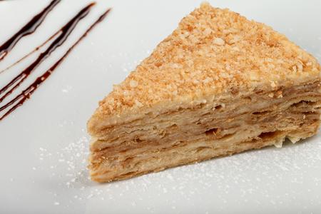 A piece of cake Napoleon on a plate. Classic Napoleon cake. Stock Photo