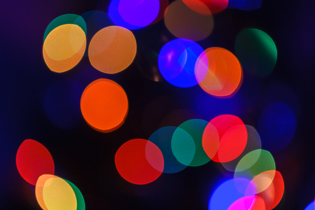 Christmas abstract blurred background. Multi-colored lights. Unfocused image