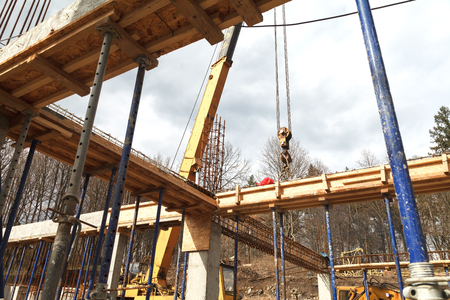 Strengthening the foundation of the second floor of the house with metal racks