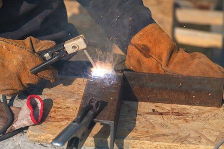 Welding work, welder welding metal material in heavy industry manufacturing