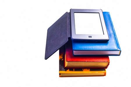 E-book lay on a pile of books on a white background photo