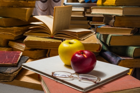 Old books apples glasses and autumn leafs photo