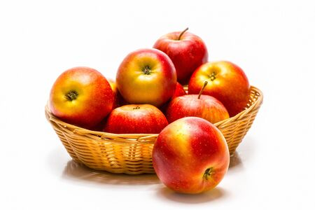 sweet red apples in a straw basket photo