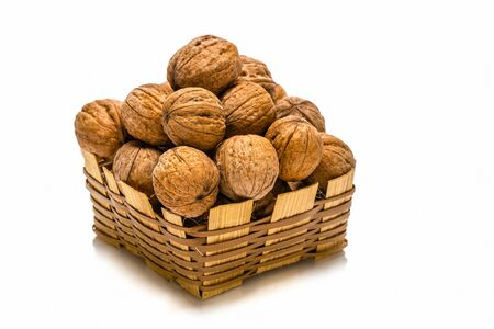 basket of walnuts isolated on white Stock Photo - 16123768