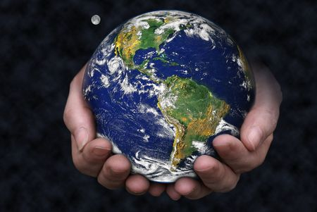 grasp: A pair of hands holding the Earth with the moon in the background.  Stock Photo