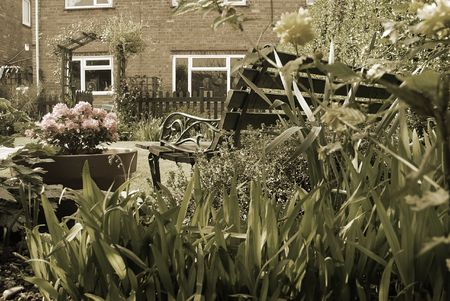 An animals eye view of an English country garden and house in monochrome photo