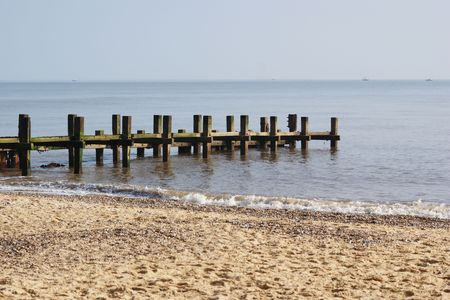A wooden groyne (groin) coastal sea defence Stock Photo