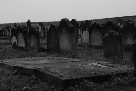A black and white picture of a graveyard