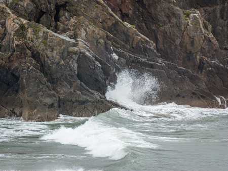 Waves breaking against a rocky cliff