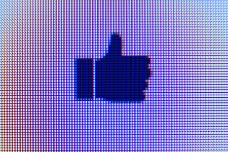 A macro shot of original thumbs-up icon on a computer screen with visible pixels  All graphics used are original  스톡 콘텐츠