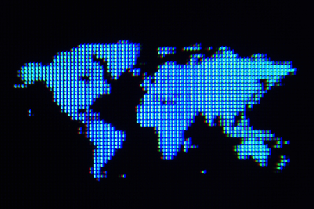 A macro shot of a blue world map graphic on a computer screen with a black background   스톡 콘텐츠