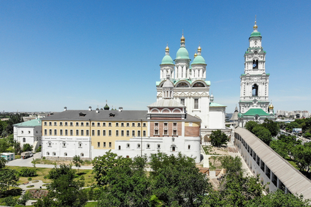 Astrakhan. Astrakhan Kremlin. Fortress. Assumption Cathedral and the bell tower of the Astrakhan Kremlin. Flying drone over the Kremlin. Panorama of the city of Astrakhan. park for rest and walks. The central embankment of the city. A cruise ship. The bri