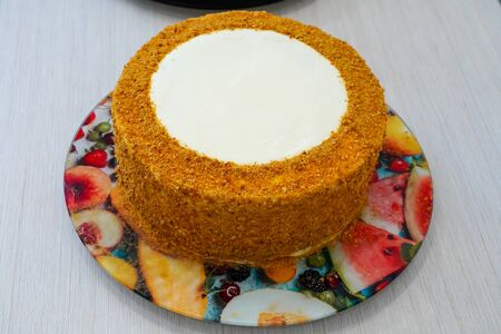 Decorating a festive cake handmade by a master pastry chef.Cook - Confectioner. Cooking and decorating festive multilayer cakes for the anniversary. The cake is ready for decoration.