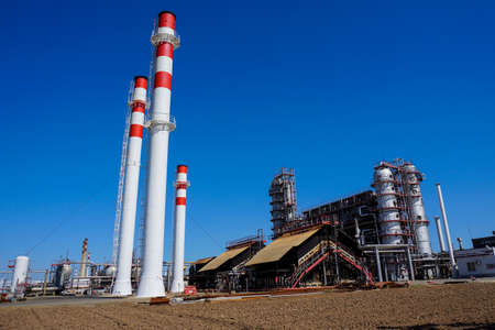Petrochemistry. A furnace for heating oil and preparing fuels and lubricants. Chimneys from industrial furnaces. Complex for the processing of hydrocarbons at an oil refinery ..