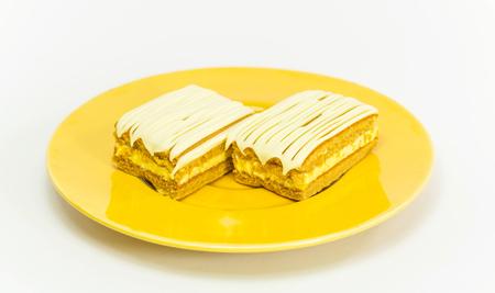 teat: banana cake on a yellow dish on white background
