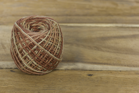 roll of colorful jute, string, hemp rope on wooden backgroun Stock Photo
