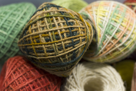 many rolls of colorful jute, string, hemp ropes