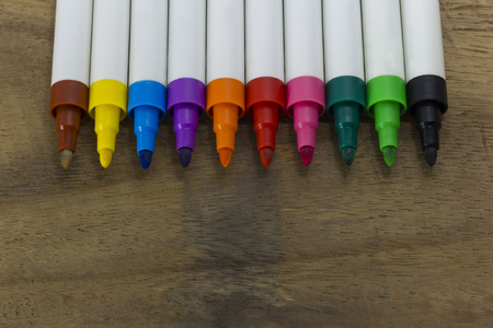 colorful marker pen on wooden background