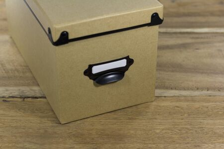 brown storage box isolated on wooden background Stock Photo