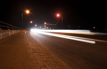 Light trails from passing cars on bridge. Stok Fotoğraf