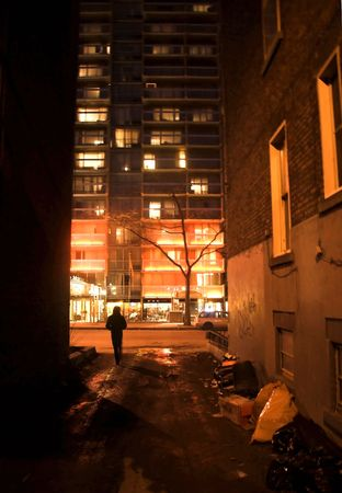 qc: Man leaving alley. Shot in Montreal, QC. Stock Photo
