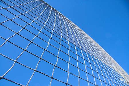 netting: Netting against blue sky background.