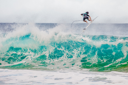 ocean and sea: Surfer at the world famous Pipeline surf break on North Shore, Oahu, Hawaii