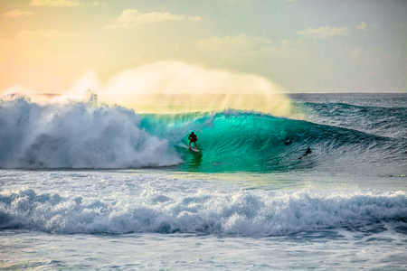 Surfer at the world famous Pipeline surf break on North Shore, Oahu, Hawaii