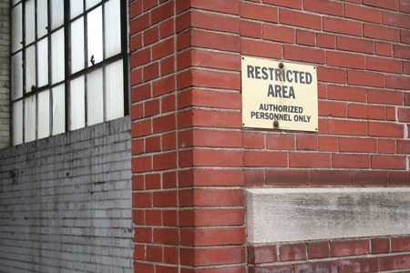 Abandon building with restricted area sign.