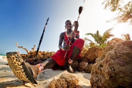masai: Maasai by the ocean on the beach  Kenya Stock Photo