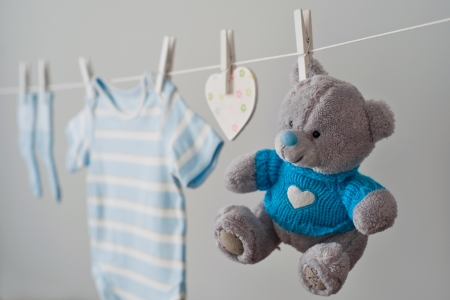 congratulation: blue baby clothes on the clothesline Stock Photo