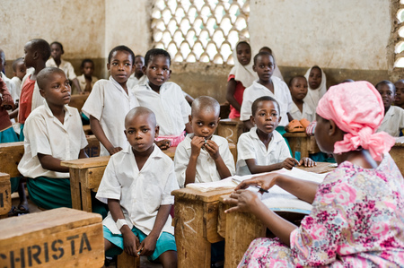 African children in school at the desks in the classroom Kenya