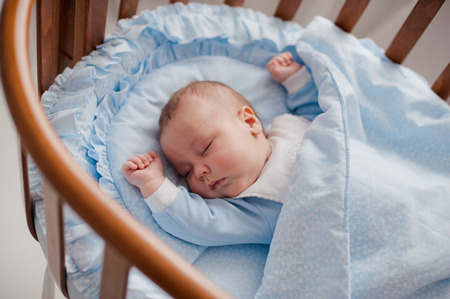 baby sleeps with a cradle at home