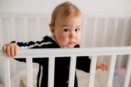 wail: The baby cries and calls mom from a bed