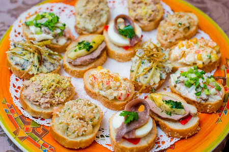 finer: Appetizers with cheese and ham vegetables on  festive table