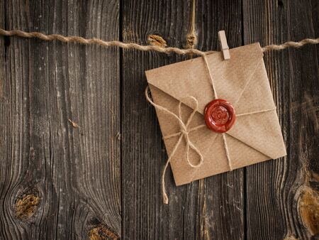 love letter with wax seal and a wooden pencil