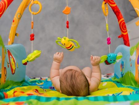 naked child: naked child playing lying on Developing rug