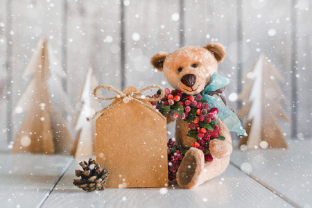 mail: Teddy Bear with a blank for congratulations on a wooden background