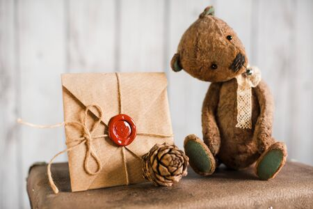 love letter: Teddy bear on a suitcase with a love letter