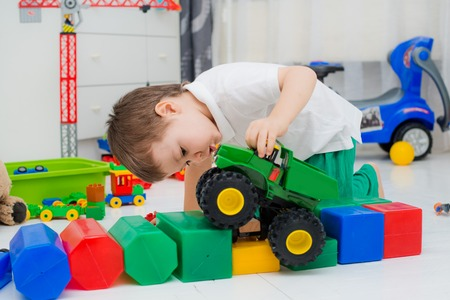 preschool kids: boy playing with the car monster truck