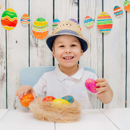 atcamera: child is happy with Easter decorations
