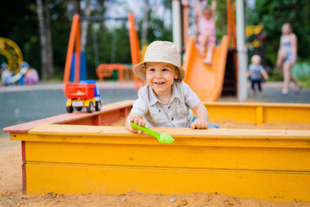sandbox: child having fun playing in the sandbox Stock Photo