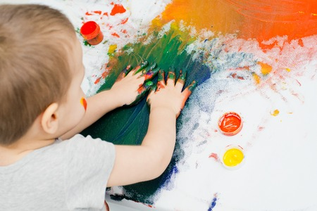 childrens hands in paint